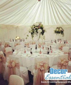 draping fabric in tent with round tables and chairs