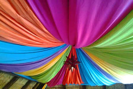 stunning colours of ponjee draped at a hall venue