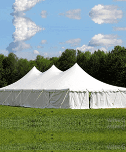 peg and pole tent on green grass , used for events