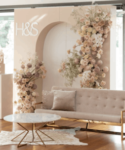 Solid Arch Backdrop With Couch and Coffee Table